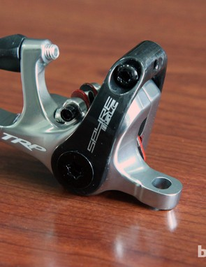 The top-end TRP Spyre SLC incorporates a molded carbon fiber cable arm that brings the claimed caliper weight down to 146g.