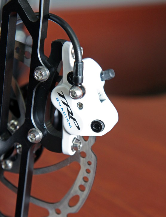TRP delayed release of the four-piston Quadiem enduro brake in order to give it a more competitive power profile.