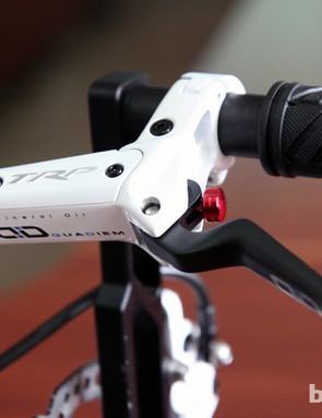 The standard TRP Quadiem four-piston hydraulic mountain bike disc brake uses an aluminum lever blade with tool-free reach adjust.