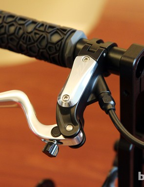 The TRP Dash Sport lever features a radial master cylinder and tool-free reach adjust.