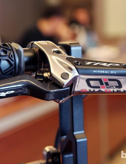 The upper-end TRP Quadiem SL lever gets a carbon fiber blade.