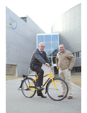 UCI President Pat McQuaid has a go on the Qhubeka bike, accompanied by JP van Zyl, Director of World Cycling Centre Africa