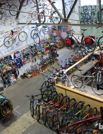 New and old bicycles fill the floor and cover the walls
