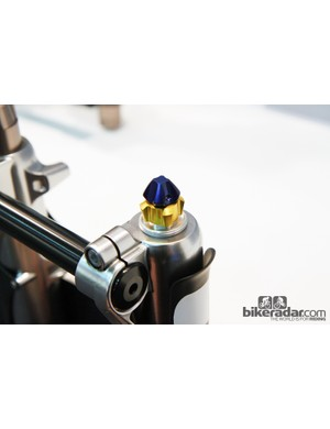 The separate high-speed and low-speed compression damping adjusters are normally protected by a removable aluminum cap.