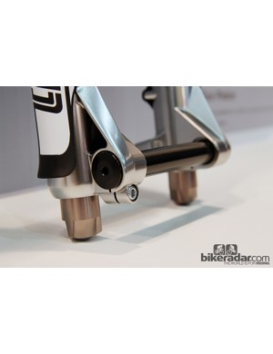 The 20mm thru-axle is secured with a single pinch bolt