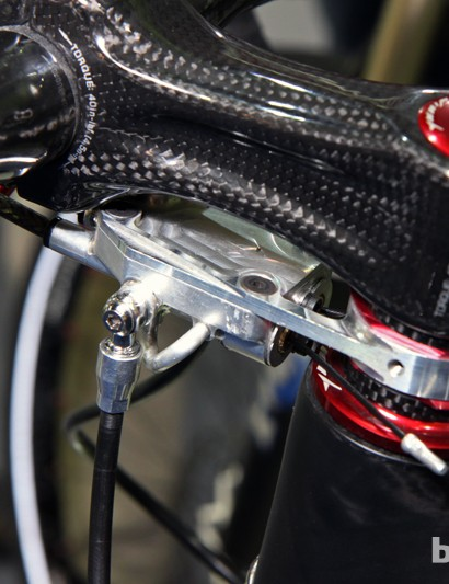Cleverly, the mounting plate also doubles as the cover for the master cylinder reservoir