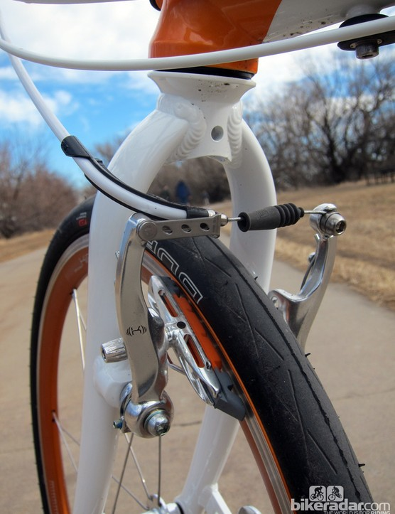 We'd normally scoff at V-brakes on a bike this expensive but they work alright in this application