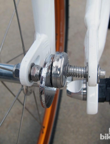 Magnetic clips hold the ends of the bike together when folded. The rear quick-release lever is swapped to the driveside for clearance