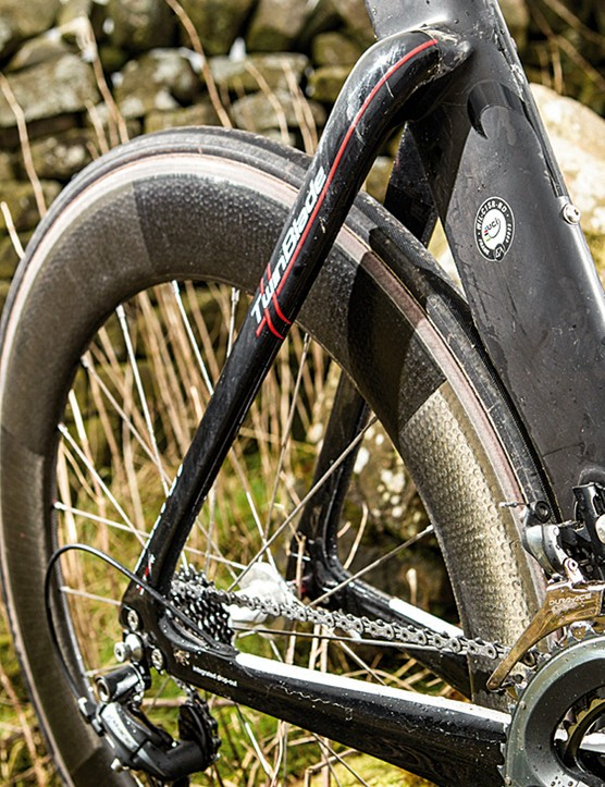 Super-deep chainstay 'thighs' mount the rear brakes underneath, behind a bottom bracket spoiler