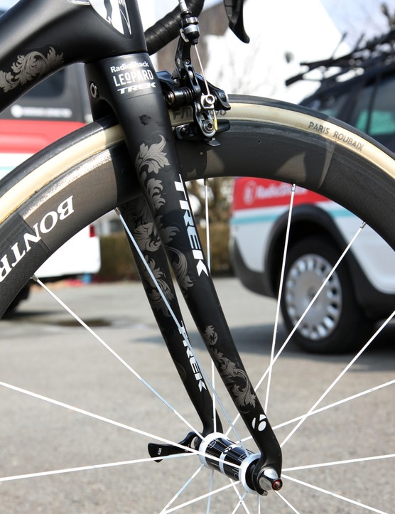 The Trek Domane 6-Series fork blades feature an exaggerated rake to help promote flex over rough surfaces. Backswept dropouts maintain a standard rake, though