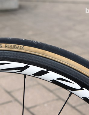 Supple-riding 25mm-wide FMB Paris-Roubaix tubulars are mounted to the Zipp 303 Firecrest rims with nary a shred of excess glue visible.