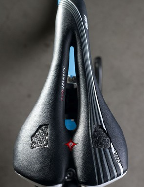 Custom carbon fiber panels cover up the hogged-out sections of the custom Specialized Ruby saddle