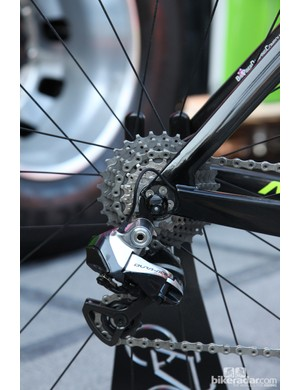 The rear derailleur cable - or wire, in this case - is routed through the chain stay