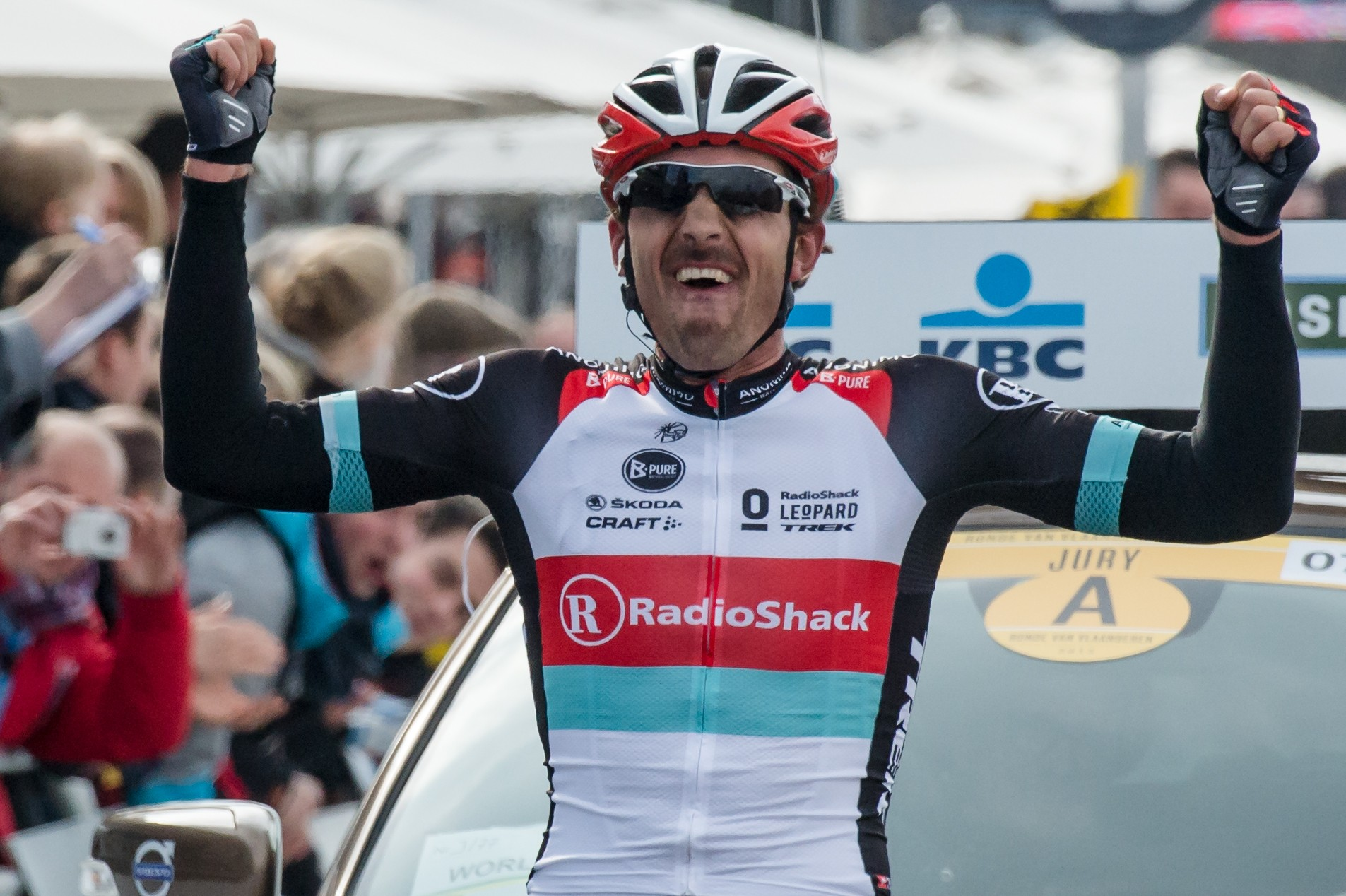 Fabian Cancellara celebrates as he crosses the finish line of the 2013 Tour of Flanders