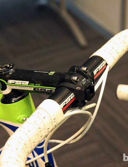 The aluminum FSA Energy T traditional-bend bar is clamped to a carbon-wrapped FSA OS-99 stem