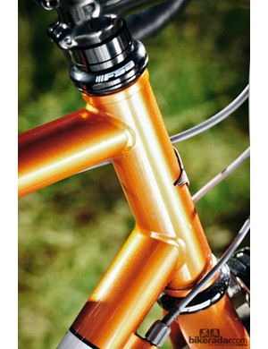 The steel frame under the copper finish delivers a springy ride