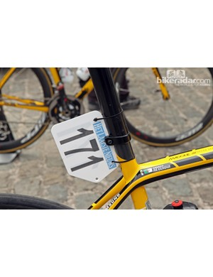 MTN-Qhubeka team mechanics use the seatmast head clamp on the Trek Madone 7-Series as a number plate mount