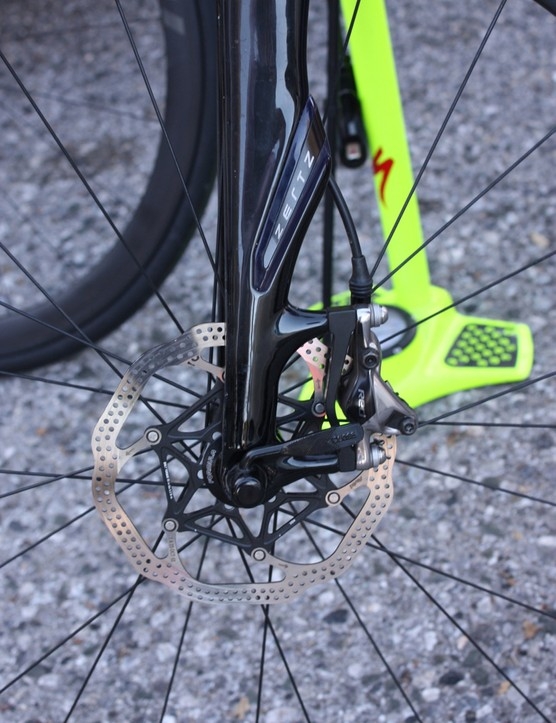 A Red hydraulic caliper on the Roubaix fork post mounts
