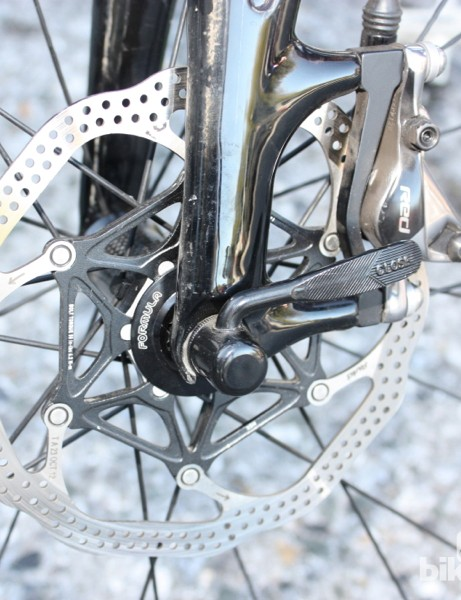 The current mechanical Roubaix Disc uses Shimano cailpers and rotors, but engineers were playing with rotors from Formula and others