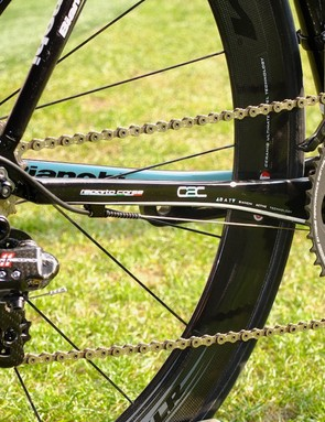 The chain stays are flattened horizontally but laterally rigid