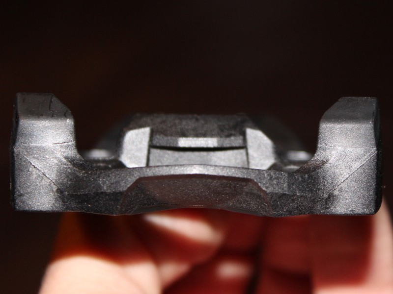 The engagement point on the cleat (at center) sits well recessed from the outer walking pads