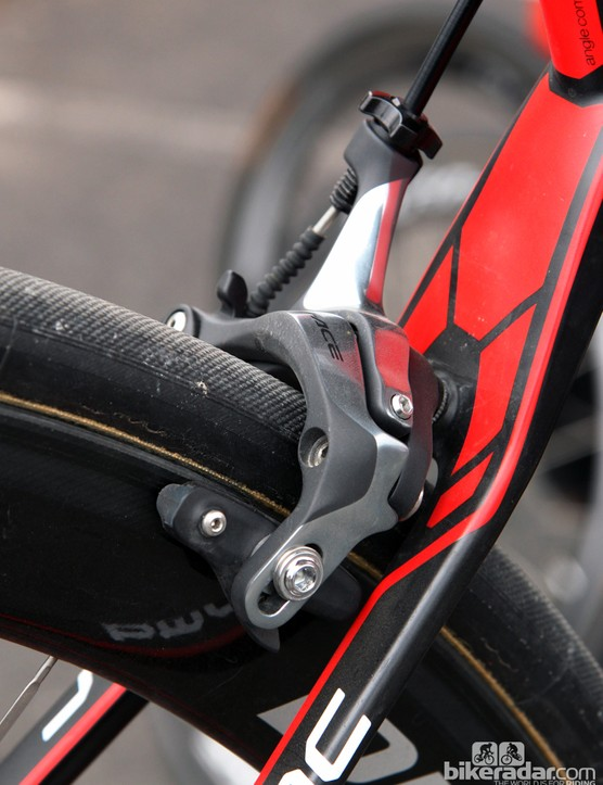 BMC has cleverly gotten around the need for long-reach calipers by angling the mounting hole. Clearance isn't fantastic beneath the outermost caliper arm but the pads easily reach around the 28mm-wide Continental tubular tires