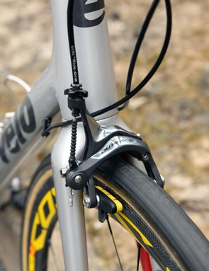 The Shimano Dura-Ace brake calipers are supplemented with Mavic carbon-specific pads (made by SwissStop) and Gore Ride-On sealed cables and housing. The longer 'SL' fork lends more room for the 27mm-wide FMB Paris-Roubaix tubulars, too - note the position of the brake pads in the slots