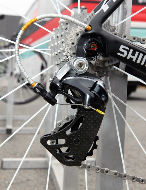 The German-made Berner carbon fiber rear derailleur cage promises lower drivetrain by virtue of its ultra-oversized pulleys. As always, Radioshack-Leopard-Trek mechanic Roger Theel has dressed up Fabian Cancellara's bike with gold anodized bits