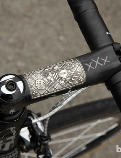 The 140mm-long Bontrager Race XXX Lite molded carbon fiber stem wears this plate for good luck