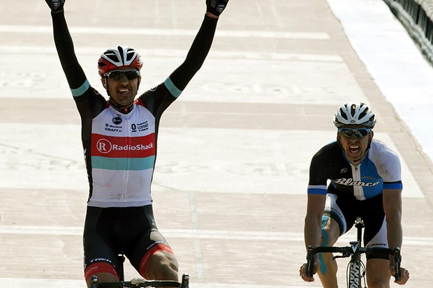 Switzerland's Fabian Cancellara, left, of the Radioshack Leopard team, celebrates as he wins the 111th Paris-Roubaix classic cycling race, while Belgium's Sep Vanmarcke of the Blanco pro cycling team, right, finishes second in Roubaix