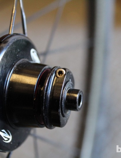 Our test set had an issue with the compression ring working its way loose. The small Allen bolt you can see tightens down the thread-on compression ring. Zipp sent a replacement axle and ring, which solved the problem