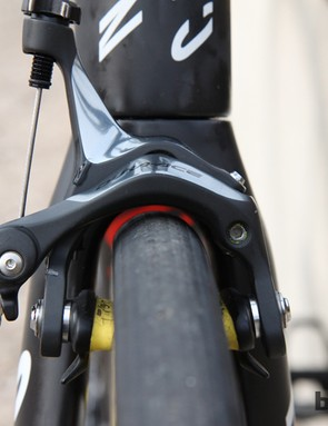 Canyon supposedly engineered the revamped Ultimate CF SLX from the outset to be compatible with higher-volume tires. Here, the 27mm-wide tubulars have little room to spare but they still fit