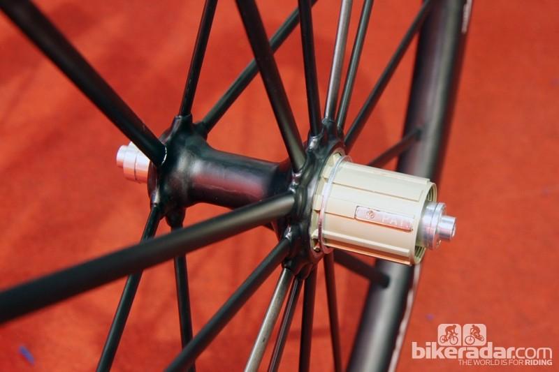 The aero-profile carbon fiber spokes are bonded to the carbon fiber hub shells on Trigon's new CW02 road wheelset