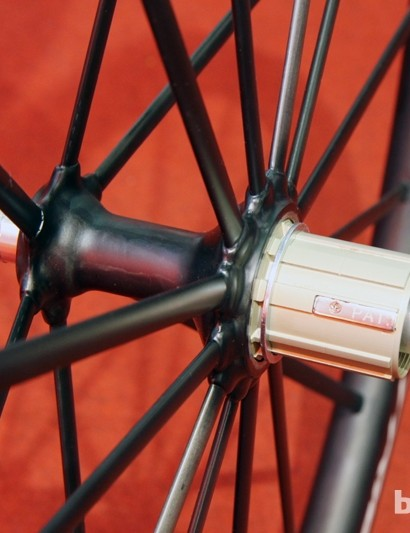 The aero-profile carbon fiber spokes are bonded to the carbon fiber hub shells on Trigon's new CW02 road wheelset