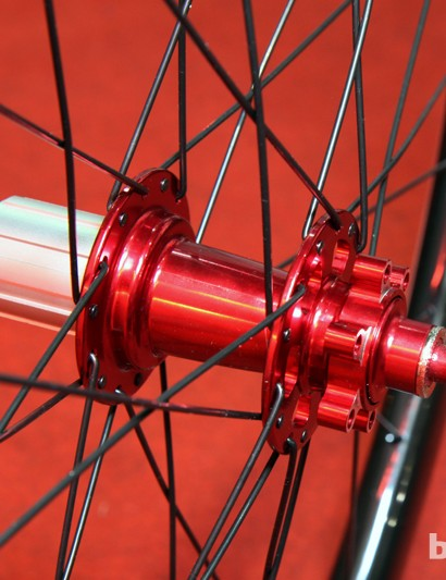 Red anodizing certainly adds some visual flair to Trigon's new CWCD40 disc-only full-carbon clinchers