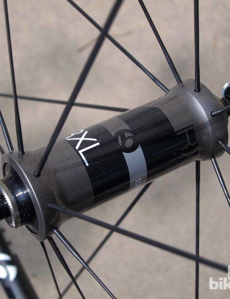 Spokes are pushed out wide on the aluminum front hub shell. Lateral stiffness feels excellent
