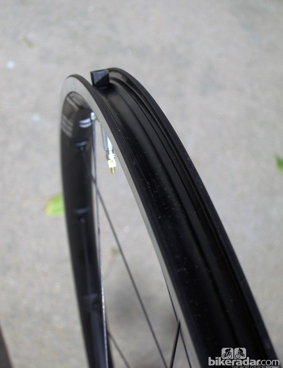 Tubeless tires seat easily with the rim strip installed - at least when the rim strip is new, that is