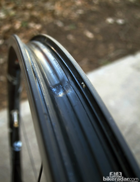 We found that the molded plastic rim strips can deform over time when the tires are inflated to typical road pressure (90-105psi). The resultant dimples made it nearly impossible to reinflate the tire with a floor pump. Bontrager has already toughened the strips up but we still found the best solution was to place a very thin, fiber-reinforced rim strip down first