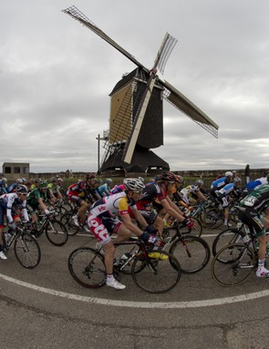 The pack passes Sint Hubertus windmill near the town of Beek during the Amstel Gold Cycling race