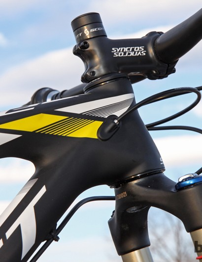 The carbon fiber housing stops for the internally routed derailleur cables are molded directly into the structure. The short tapered head tube and 'tweener wheels easily allow for aggressively low bar heights even for riders of shorter stature