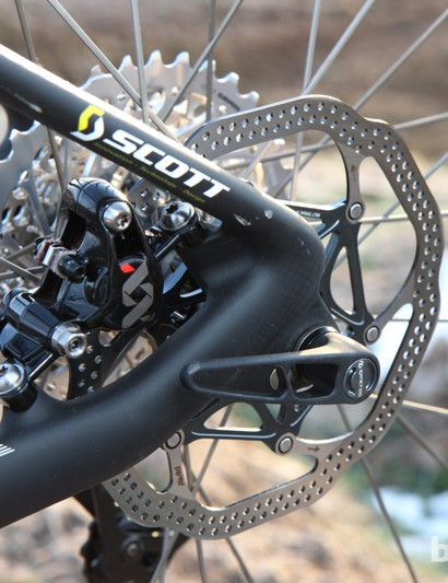 The rear caliper bolts to post-mount tabs inside the looped stays