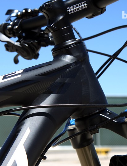 Scott includes a tapered head tube on the Scale 740 while cables are externally routed