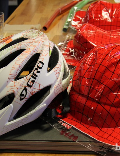 A finished Xar helmet alongside the template used to creating its graphics