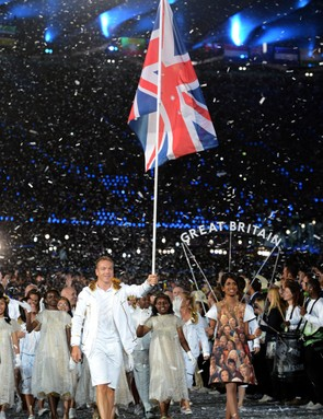 Sir Chris Hoy carrying the team flag during the London Olympic Games 2012 Opening Ceremon