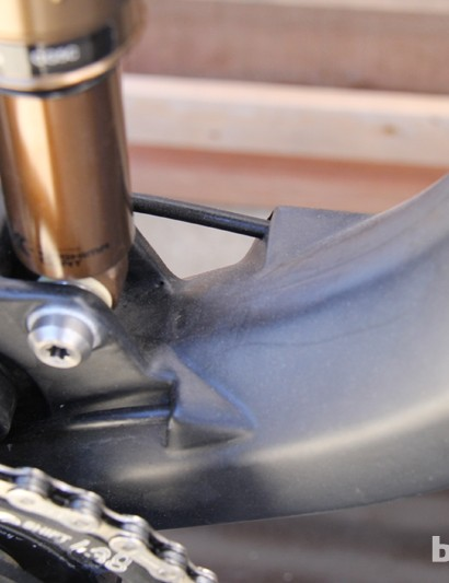 The rear brake and rear derailleur lines exit the downtube in front of the bottom bracket shell