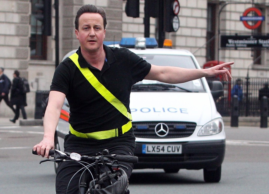 Conservative Party Leader David Cameron arrives by bicycle at the House of Commons in central London, for the last Prime Minister's Question Time before the General Election.