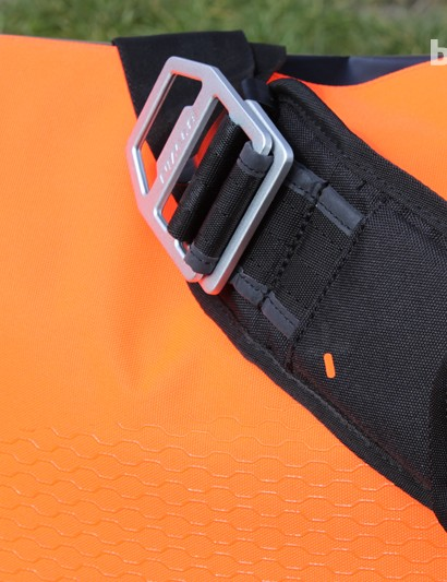 The bright orange back panel features silicone grippers to stop the bag moving around as you ride