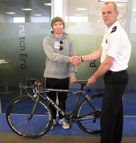 Georg Mew Jensen with Police Cycle Task Force Inspector Peter Salter and Georg's bike