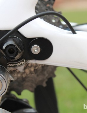 The Allen bolt to the right of the quick-release nut sets the horizontal position after it's set by the rear screw