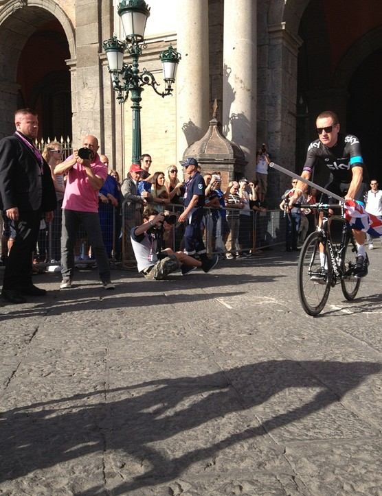 Team Sky's Bradley Wiggins rolls out into the piazza to be presented